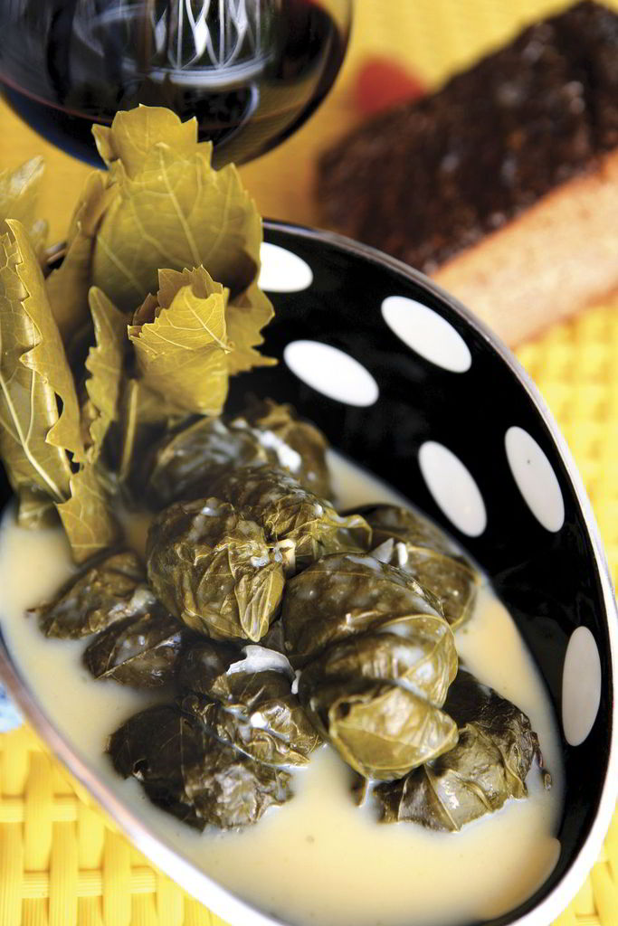Yiouvarlakia (rice meatballs) in vine leaves and egg and lemon sause